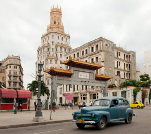 1950s-style car in front of Chinese architecture in Havana, Cuba in 1998.