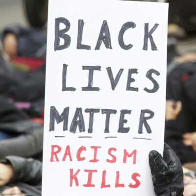 Protestor holding up Black Lives Matter poster